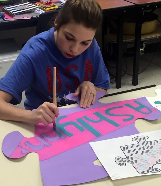 Art+students+create+puzzle+pieces