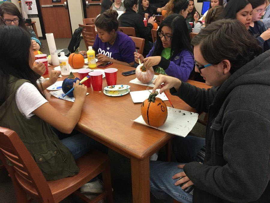 Journalism staff paints pumpkins