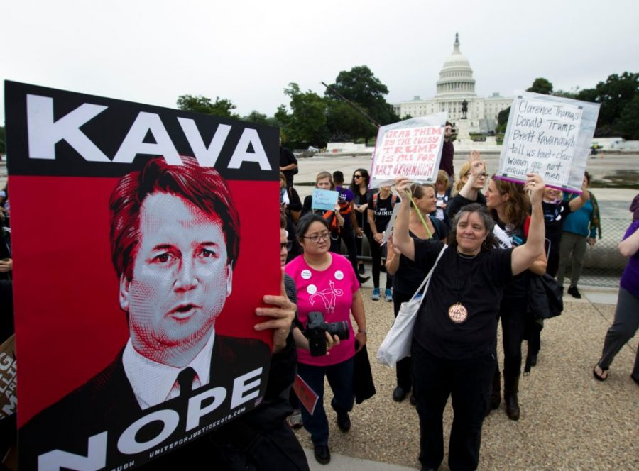 Demonstrators protest against the appointment of Supreme Court nominee Brett Kavanaugh on the streets outside on Capitol Hill in Washington DC, on September 27, 2018. - Christine Blasey Ford told senators Thursday that she remains