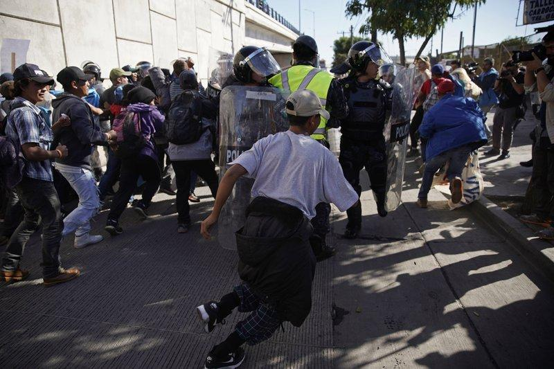Migrants shot with tear gas