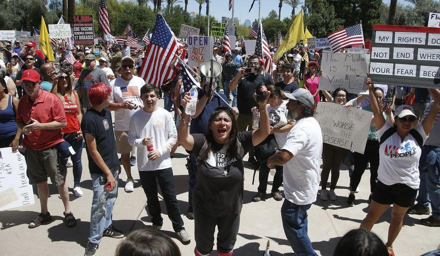 Protesters rallying to open states back up
