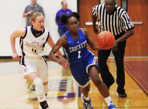 Freshman Elizabeth  Daniel races to stay on the defensive during a game against Crockett.