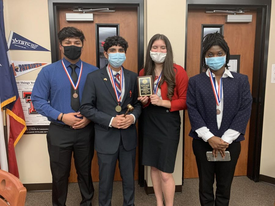 The CX debate team shows off their medals after placing at the district meet.