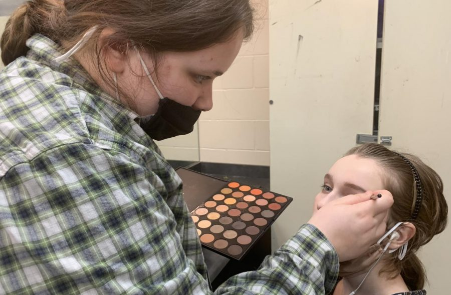 Sophomore Millie Lane works on makeup for Lindsey Hardin before district OAP competition. The play earned high marks and will advance to Bi-District.