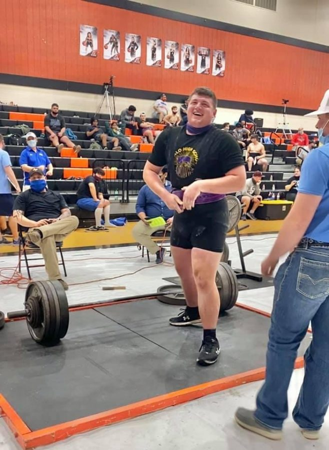 Senior Asa Henson gives a grin as he finishes the lift that put him in the top five contestants at this week's regional powerlifting meet.