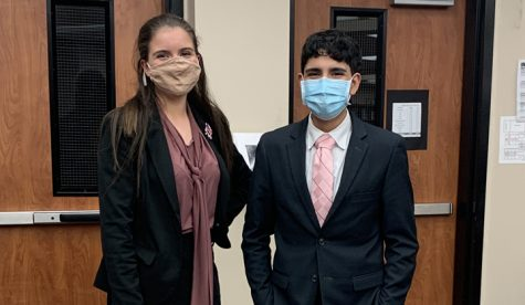 the typical post-competition victory photo had to take place without medals to show off. In a year of COVID and virtual debate, they will  be mailed. Freshman Nicollette Arabie and junior Omar Almeida made it to finals, earning octafinal medals.