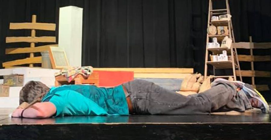 Freshman Billy Duncan takes a nap after eating a doughnut breakfast and before rehearsing one last time at the end of the annual lock-in.