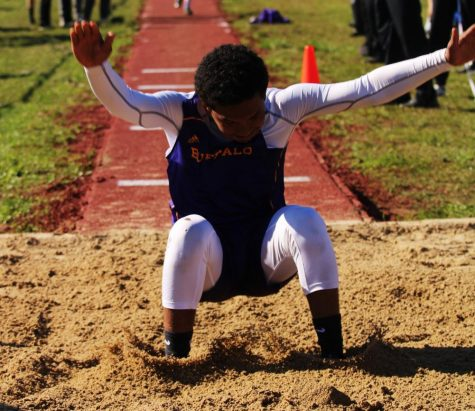 Freshman Aiden Savage sticks his landing while competing in the triple jump. Several students advanced to area in field events. The area meet will be next week in Crockett.