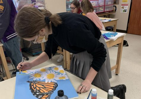 Sophomore Lindsey Hardin puts finishing touches on her contribution to the newly-remodeled Lord