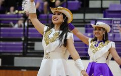 Bison Belle Captain April Martinez salutes to the crowd as she is introduced at Meet the Bison. April is a four-year member of the Belles.