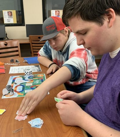 Sophomore Tiler Jameson and freshman Johnny Clements play a round of Call of the Wild after finishing their board game. The  students finished the novel this week.