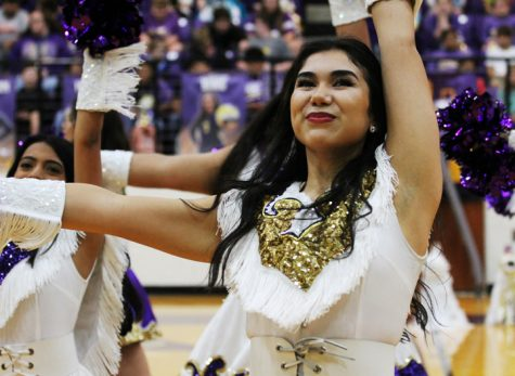 Belle Captain April Martinez leads her team while performing at a pep rally. When April is not busy with school activities, she works for Kona Ice.